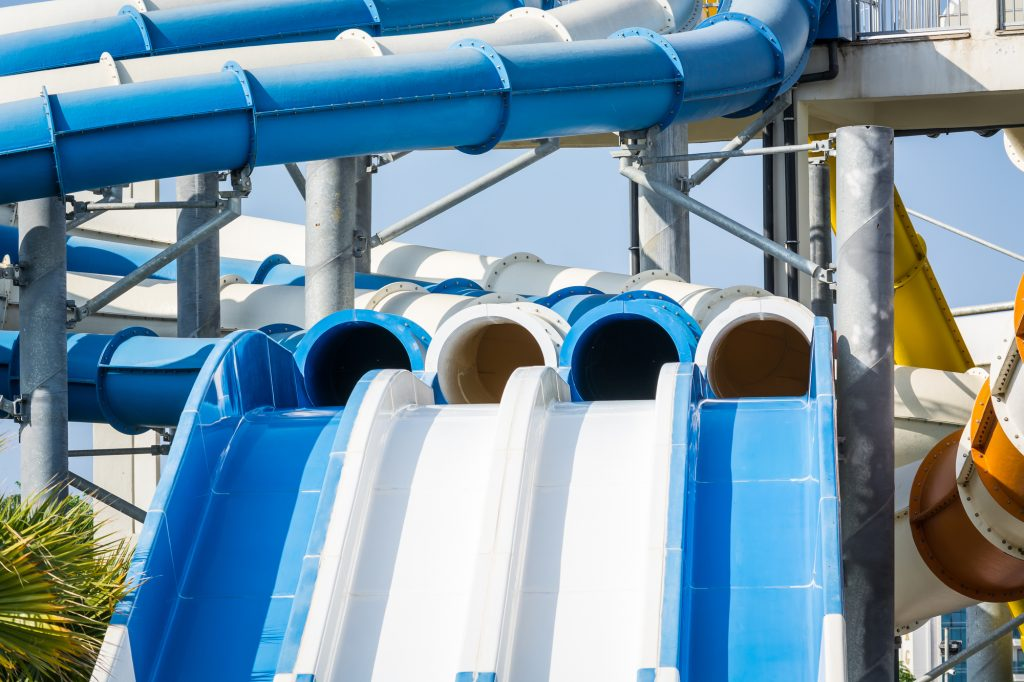 Steep water slides with pipes in water park