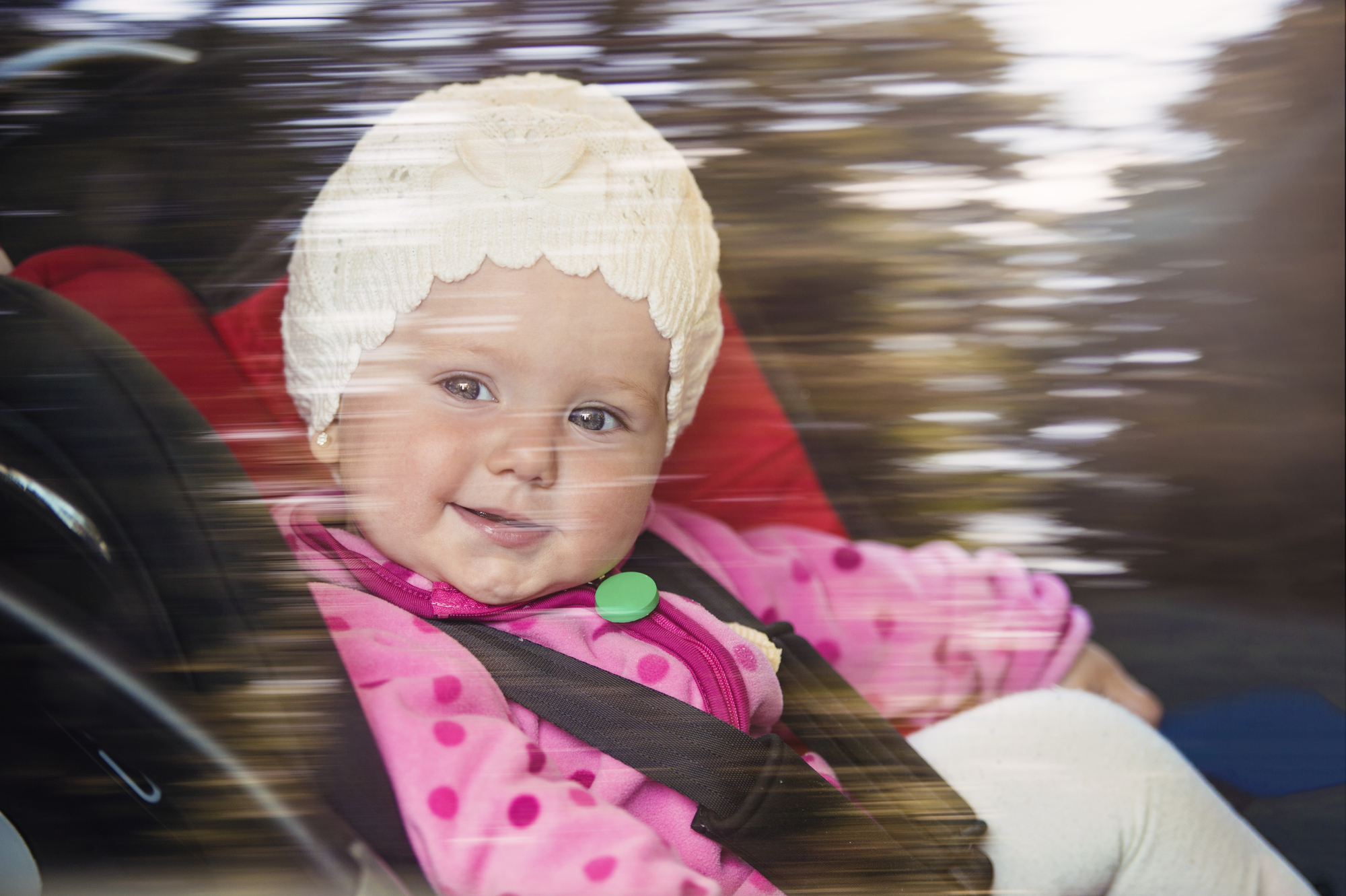 Baby Girl Smiling, Sitting in Car Seat