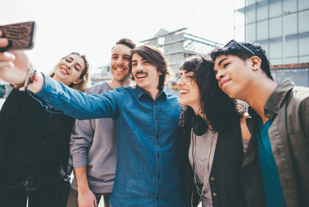 Group of young friends taking a selfie